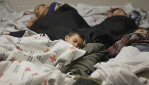 A family-oriented image of illegal migrants sleeping together - women with children